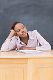 Close up of a thoughtful black woman on desk