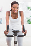 Black woman doing exercise bike