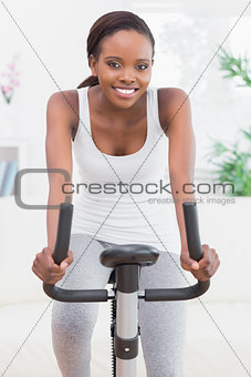 Black woman doing exercise bike