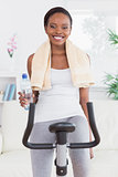 Black woman on bike holding a water bottle