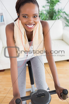 Black woman doing sport while listening music