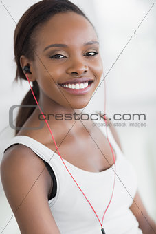 Close up of a black woman listening music