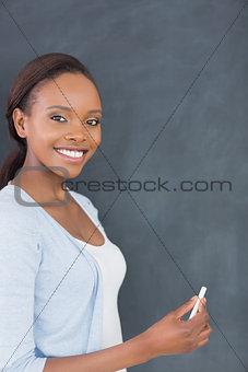 Black woman holding a chalk