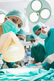 Focus on a nurse holding an anesthesia mask