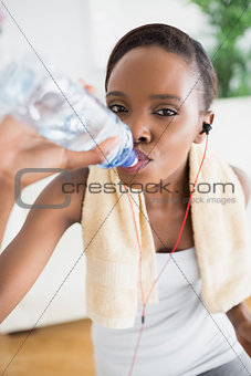 Close up of a black woman drinking