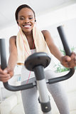 Front view of a black woman doing exercise bike