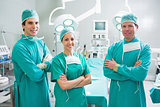 Surgeons standing up with arms crossed