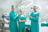 Surgeons with arms crossed smiling