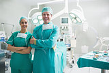 Surgeons standing up while smiling