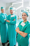 Surgical team standing up with arms crossed