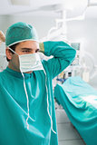 Close up of a surgeon putting his mask