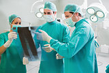 Close up of a surgical team analysing a X-ray
