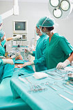 Surgeons checking a monitor while operating