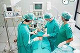 Surgeons operating a patient in an operating theater