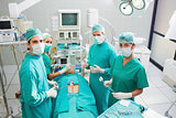 Group of surgeon working on a patient in an operating theater