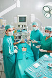 Group of surgeons operating a patient in an operating theater