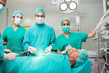 Surgical team looking at camera