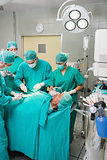 Surgeons and nurses around a patient