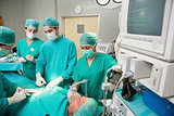 Surgical team next to a monitor