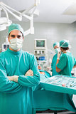 Surgeon looking at camera with arms crossed