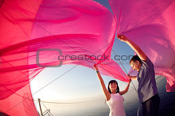 couple under the sail