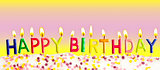 Happy birthday lit candles on colorful background