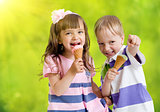 Children with icecream cone outdoor in hot summer day