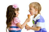 girl shares, gives or feeds boy with her ice cream in studio iso