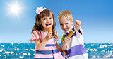 Children with icecream cone outdoor on seashore in hot summer da