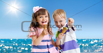 Children with icecream cone outdoor on seashore in hot summer da