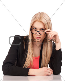 Business woman looking at you over glasses