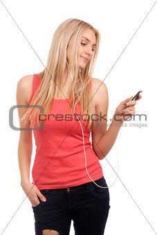 Blond teenage girl listen music