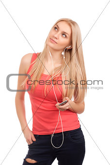 Blond teenage girl listen music and dreaming