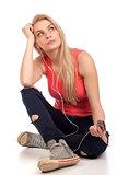 Blond teenage girl sitting and listen music