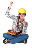 Female builder raising fist