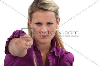 Angry woman pointing her finger