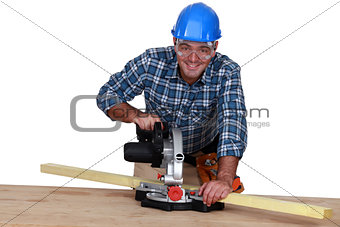 A carpenter with a circular saw.