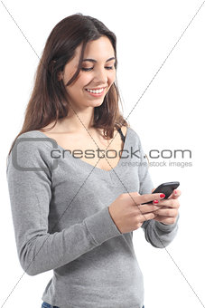 Beautiful girl sending a message with a mobile phone