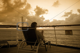 A man sitting looking out to sea