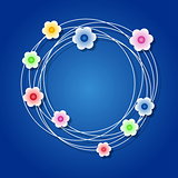 Colored floral wreath on blue background