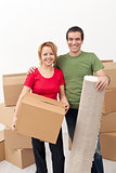 Happy couple moving into a new home