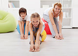 Happy family doing stretching exercises at home
