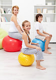 Happy family exercising at home