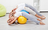 Happy healthy people exercising at home