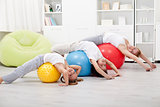 Kids and woman doing stretching exercises