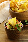 guacamole and corn chips - avocado and tomato dip