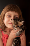child with a kitten