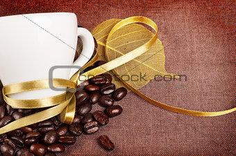 Coffee cup with yellow ribbon