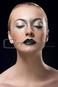 blonde girl with dark lipstick looks down