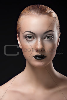 blonde girl with dark lipstick in front of the camera
